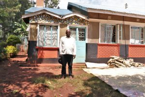 The Water Project:  Sir Pius Outside His House