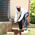 The Water Project: Irumbi Community, Shatsala Spring -  Handwashing At His Home Rain Tank