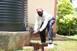 The Water Project:  Handwashing At His Home Rain Tank