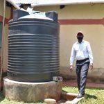The Water Project: Irumbi Community, Shatsala Spring -  Next To His Home Rainwater Harvesting Tank