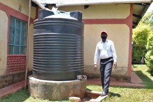 The Water Project:  Next To His Home Rainwater Harvesting Tank