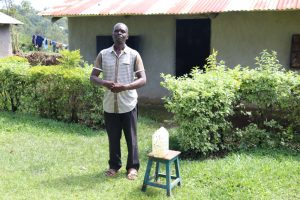 The Water Project:  Next To The Handwashing Station At His House