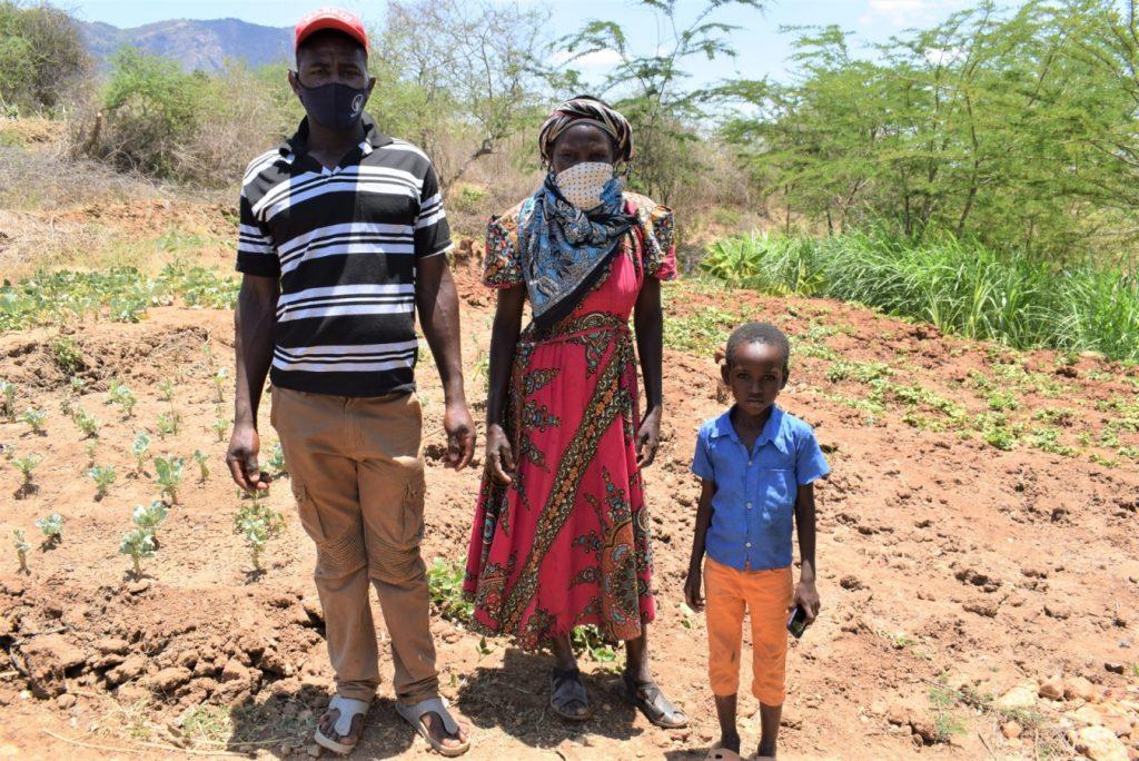 The Water Project : covid19-kenya19233-matthew-mulandi-alongside-a-community-member