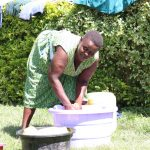 The Water Project: Shitoto Community, Abraham Spring -  We Found Brenda Washing Her Clothes