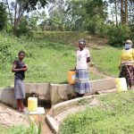 The Water Project: Handidi Community, Malezi Spring -  Gracy At The Spring With Others