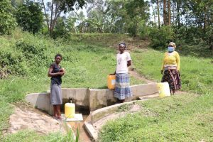 The Water Project:  Gracy At The Spring With Others