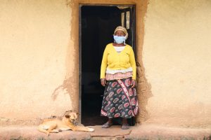The Water Project:  Gracy In Front Of Her House