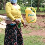 The Water Project: Handidi Community, Malezi Spring -  Showing Her Soap And Leaky Tin