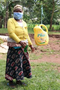 The Water Project:  Showing Her Soap And Leaky Tin