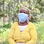 The Water Project: Handidi Community, Malezi Spring -  With Her Mask On
