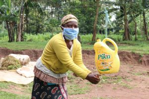 The Water Project:  Washing Her Hands At Home