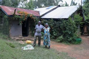 The Water Project:  Laurence And His Wife Outside Their Home