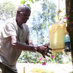 The Water Project: Shitoto Community, Laurence Spring -  Laurence Washing His Hands