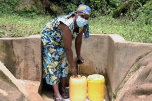 The Water Project:  Mrs Nashirobe Fetching Water From Laurence Spring