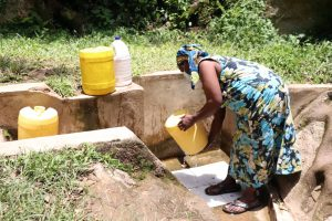 The Water Project:  Rinsing Her Container Before Fetching Water