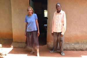 The Water Project:  Loice With Her Husband In Front Of Their House