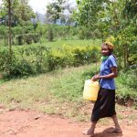 The Water Project: Luyeshe Community, Simwa Spring -  Ms Loice Heading To The Spring