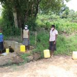 The Water Project: Luyeshe Community, Simwa Spring -  Physical Distancing At The Spring