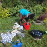 The Water Project: Isanjiro Community, Musambai Spring -  Doing The Laundry