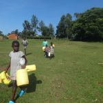 The Water Project: Isanjiro Community, Musambai Spring -  Heading To Fetch Water