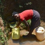 The Water Project: Shianda Commnity, Mukeya Spring -  Collecting Water