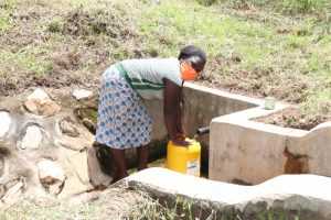 The Water Project:  At Weku Spring Fetching Water