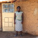 The Water Project: Ematetie Community, Weku Spring -  Doris In Front Of Her House
