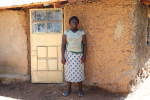 The Water Project:  Doris In Front Of Her House