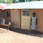 The Water Project: Ematetie Community, Weku Spring -  Doris Outside Her House