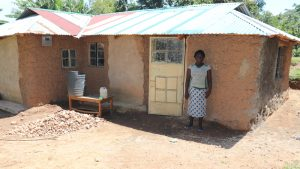 The Water Project:  Doris Outside Her House