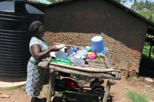 The Water Project:  Getting Plates From The Dishrack To Serve Lunch