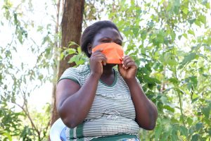 The Water Project:  Putting On Her Mask