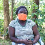 The Water Project: Ematetie Community, Weku Spring -  With Her Mask On