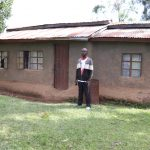 The Water Project: Ematetie Community, Chibusia Spring -  Benson In Front Of His House