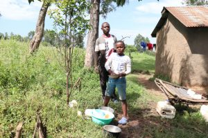 The Water Project:  Joshua Washing Utensils