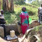 The Water Project: Ematetie Community, Chibusia Spring -  With Community Members At The Spring
