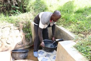 The Water Project:  Fetching Water For His Cow