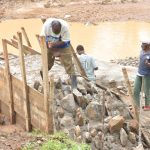The Water Project: Mbitini Community -  Working On Dam Wing Walls