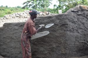 The Water Project:  Applying Concrete To The Outside Walls