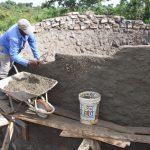 The Water Project: Kimuuni Secondary School -  Building Tank Walls