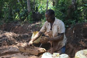 The Water Project:  Amos Modeling Mud For Bricks