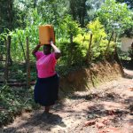 The Water Project: Elwichi Community, Mulunda Spring -  Dora And Ruth Arriving Home