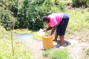 The Water Project:  Dora Carefully Fetching Water