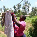 The Water Project: Elwichi Community, Mulunda Spring -  Dora Drying Her Laundry