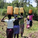 The Water Project: Elwichi Community, Mulunda Spring -  Headed Home With Water
