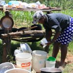 The Water Project: Elwichi Community, Mulunda Spring -  Miss Lusiche Washing Dishes