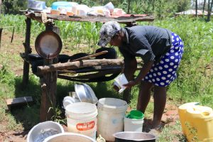 The Water Project:  Miss Lusiche Washing Dishes