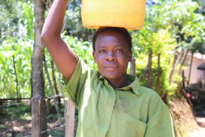 The Water Project:  Ruth Carrying Water
