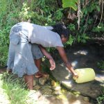 The Water Project: Kalenda A Community, Moro Spring -  Juliet Fetching Water