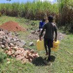 The Water Project: Kalenda A Community, Moro Spring -  Samuel Leaving With Water Form The Spring